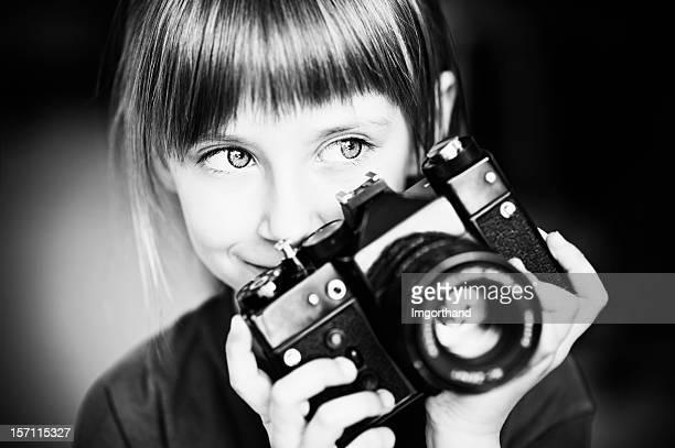 Rapariga com vintage Câmera