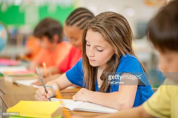 Little Girl Writing in Her Journal