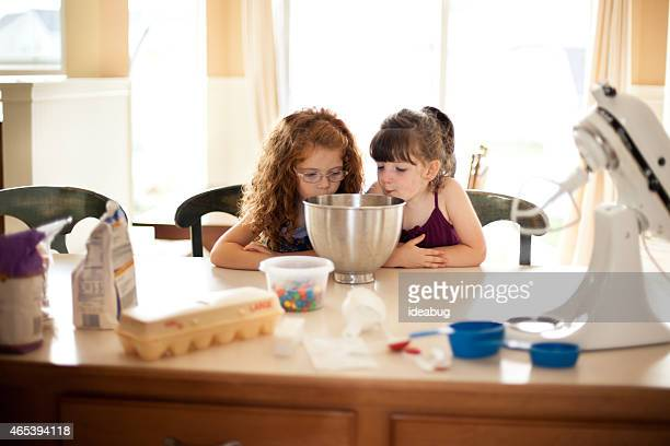 Little Girls at Kitchen Counter with Baking Ingredients and Tools