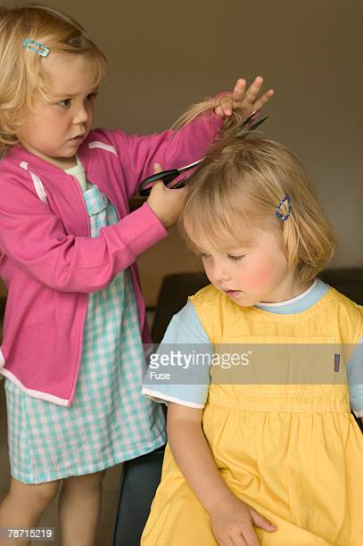 Little Girls Cutting Each Other's Hair with Scissors