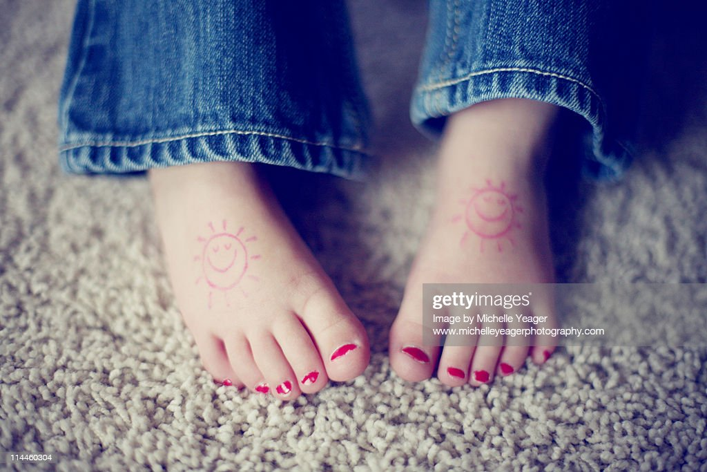 Little girls feet with painted toenails. : Stock Photo