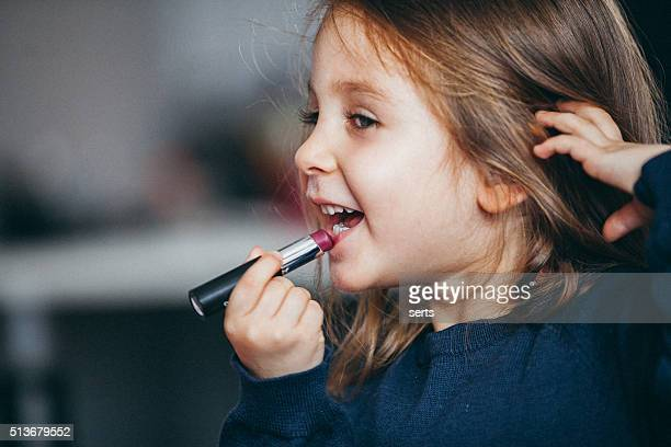 Little girl's first lipstick