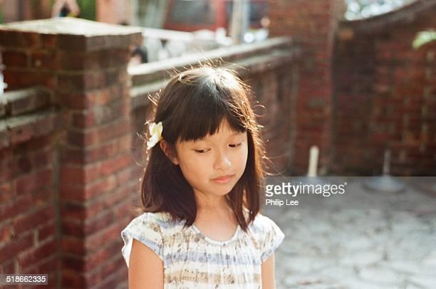 Little girl's hair with single flower