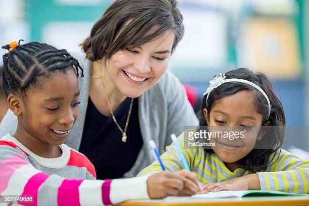 Little Girls Happily Working in Class