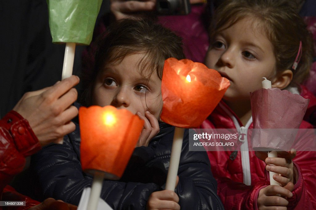 Little girls hold candles during the celebration of the Way of the Cross on Good Friday on March 29, 2013 in Rome.