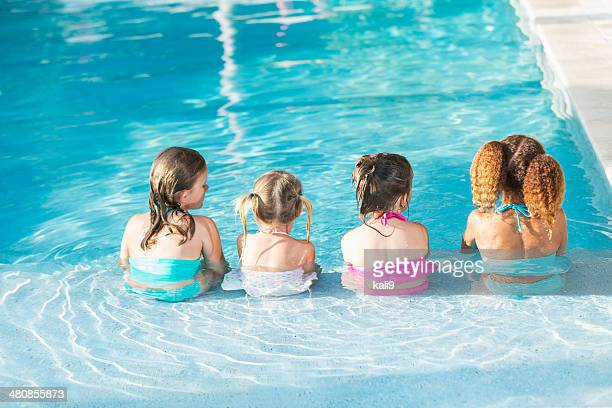 Little girls in swimming pool