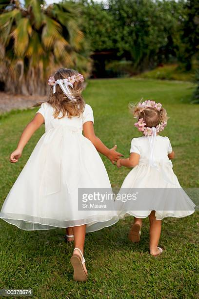 little girls in white dresses running