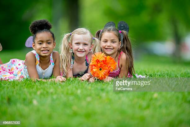 Little Girls Lying in the Grass