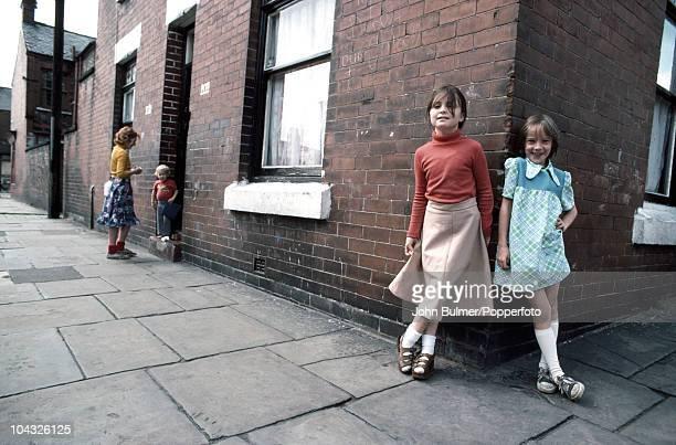 Little girls on a street corner in Manchester 1977