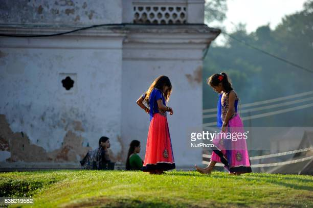 Little girls playing around Pashupatinath Temple during Teej festival celebrations at Pashupatinath Temple Kathmandu Nepal on Thursday August 24 2017...