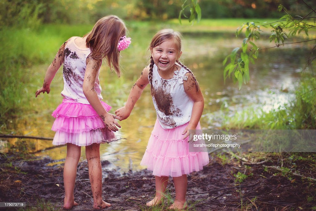 little girls playing in mud