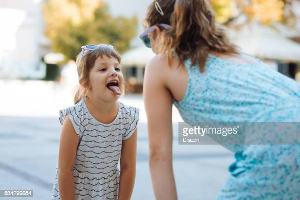 Little girls playing outdoors together