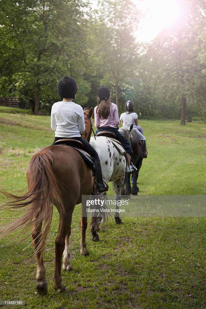 Little girls riding horses