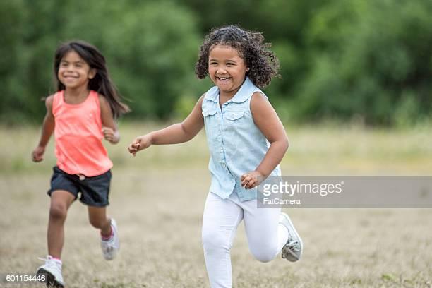 Little Girls Running Together