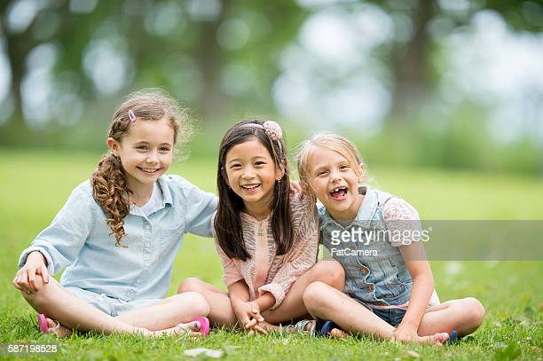 Little Girls Sitting in the Grass