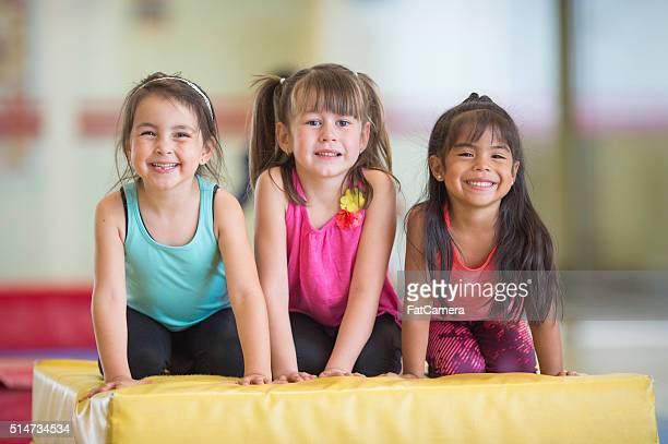 Little Girls Taking Gymnastics