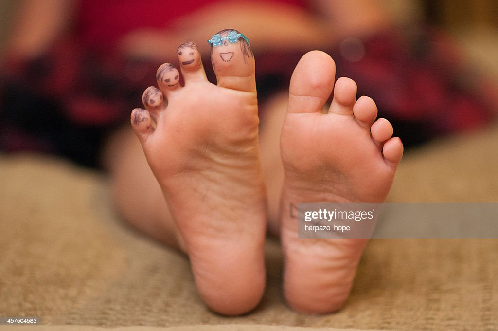 Little Girl's Toes with Faces : Stock Photo