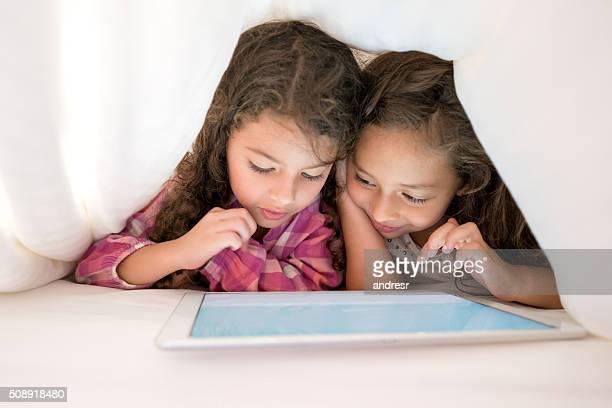 Little girls using a tablet computer