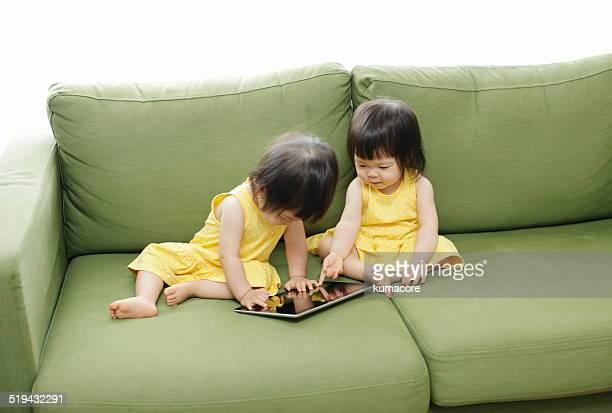 Little girls using digital tablet