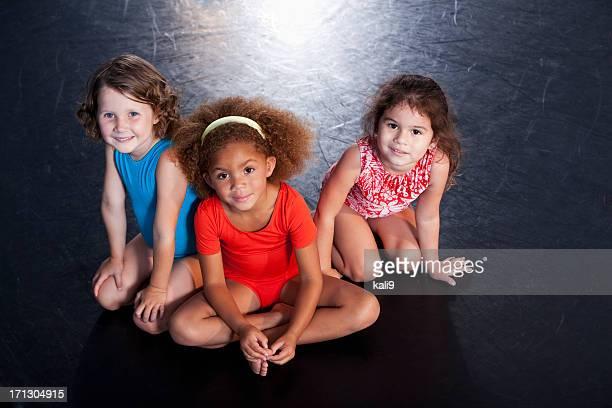 Little girls wearing leotards