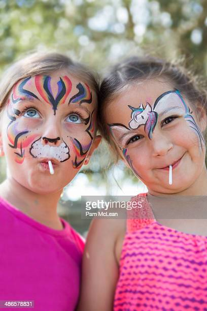 Little girls with painted faces.