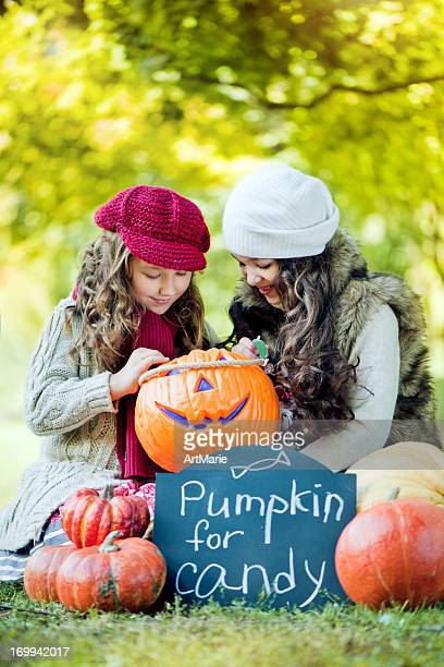 Little girls with pumpkins