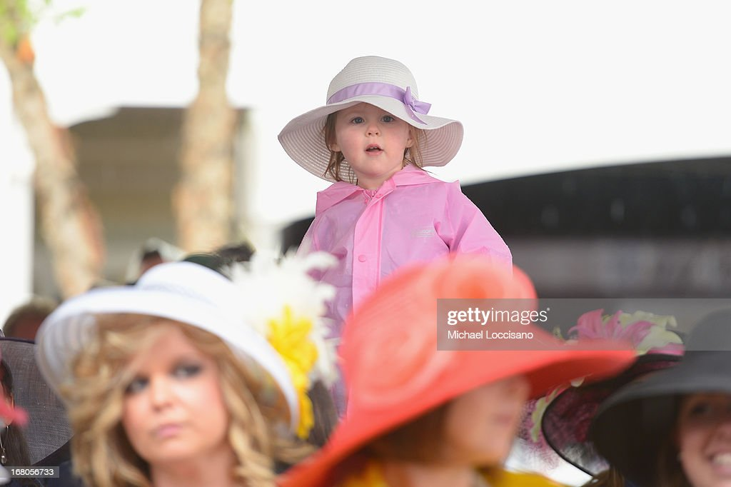 A little guest attends the 139th Kentucky Derby at Churchill Downs on May 4, 2013 in Louisville, Kentucky.
