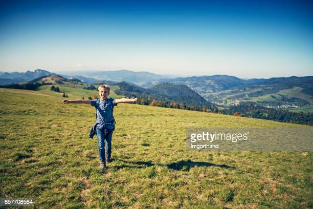 Little hiker running on hilltop