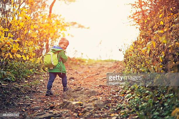Little hiker walking on dirt path