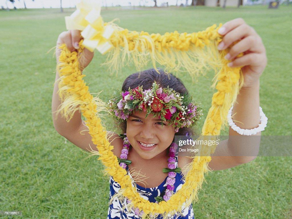 Little hula girl and garland : Stock Photo