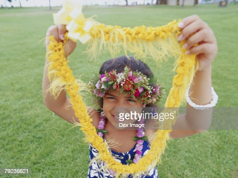 Little hula girl and garland : Stock Photo