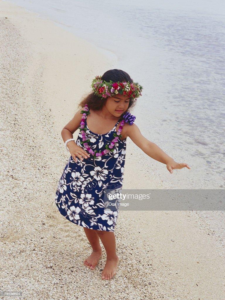 Little hula girl dancing at a beach : Stock Photo