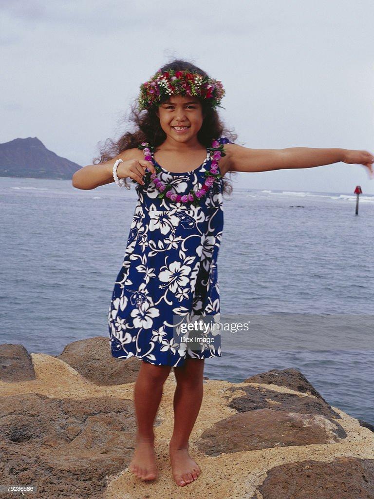 Little hula girl dancing near ocean : Stock Photo