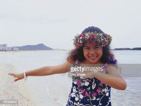 Little hula girl dancing near ocean : Stock Photo