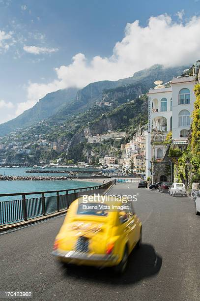 Little Italian car (fiat 500) on the Amalfi coast
