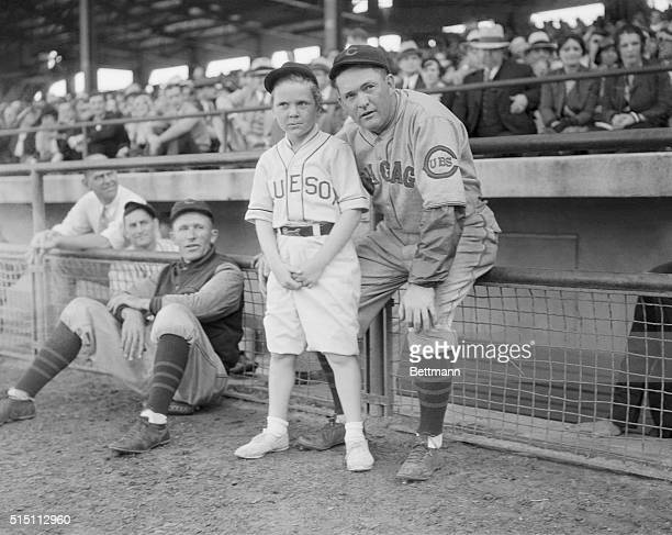 Little Jackie Cooper child film star is also a diamond fan and enthusiastic baseballer Here he is shown with Rogers Hornsby the Manager of the...