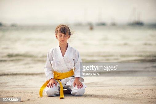 Little karate girl focusing