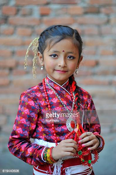 A Little kid girl in a traditional attire participate in the parade of Nhu Dan which falls on Tihar or Deepawali and Dewali Festival of Lights at...