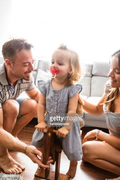 little kid playing with the family