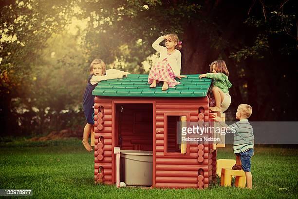 Little kids climbing on play house