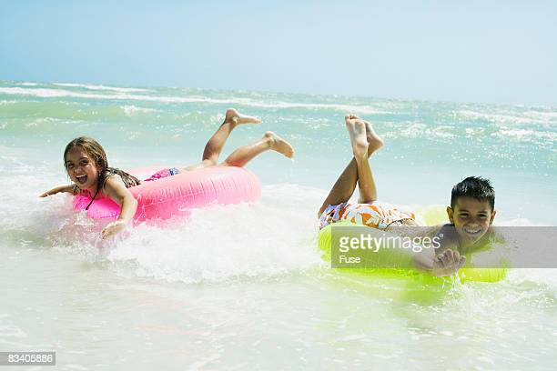 Little Kids Floating in Waves