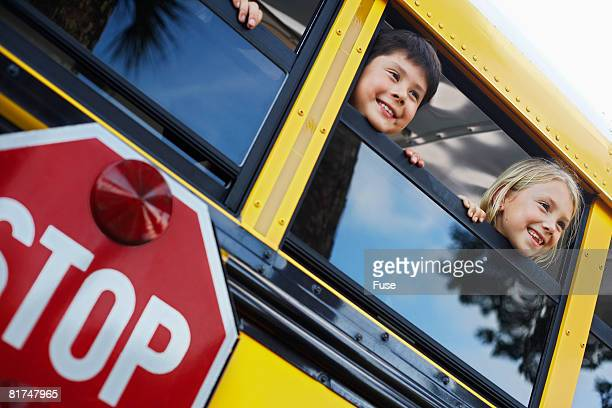 Little Kids Looking out a School Bus Window