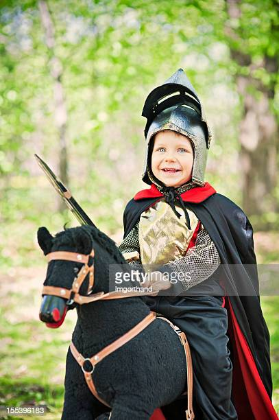 Little knight riding through the woods