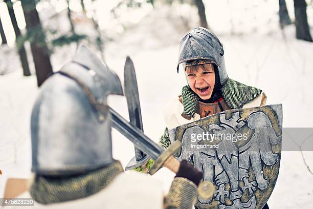 Little knights fighting in frozen forest