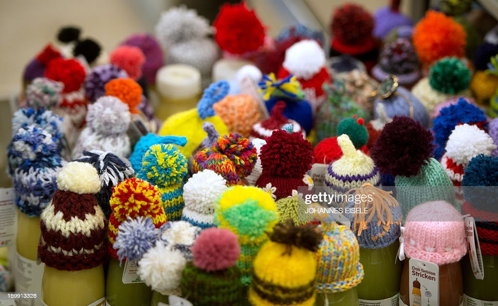 Little knitted caps are placed on top of Fruit smoothies during the 2013 World Economic Forum Annual Meeting on January 23, 2013, at the Swiss resort of Davos. The World Economic Forum (WEF)is taking place from January 23 to 27.