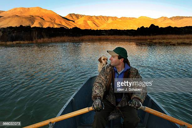 Little Lake Ranch member Chuck Brill a commercial real estate broker from Palos Verdes loves to take the boat out at sunrise with his yellow lab...