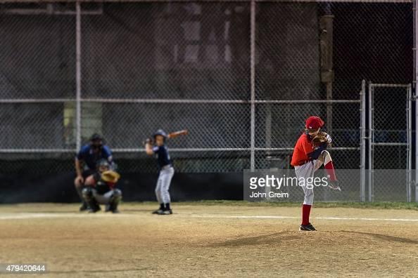 Little League baseball game at night