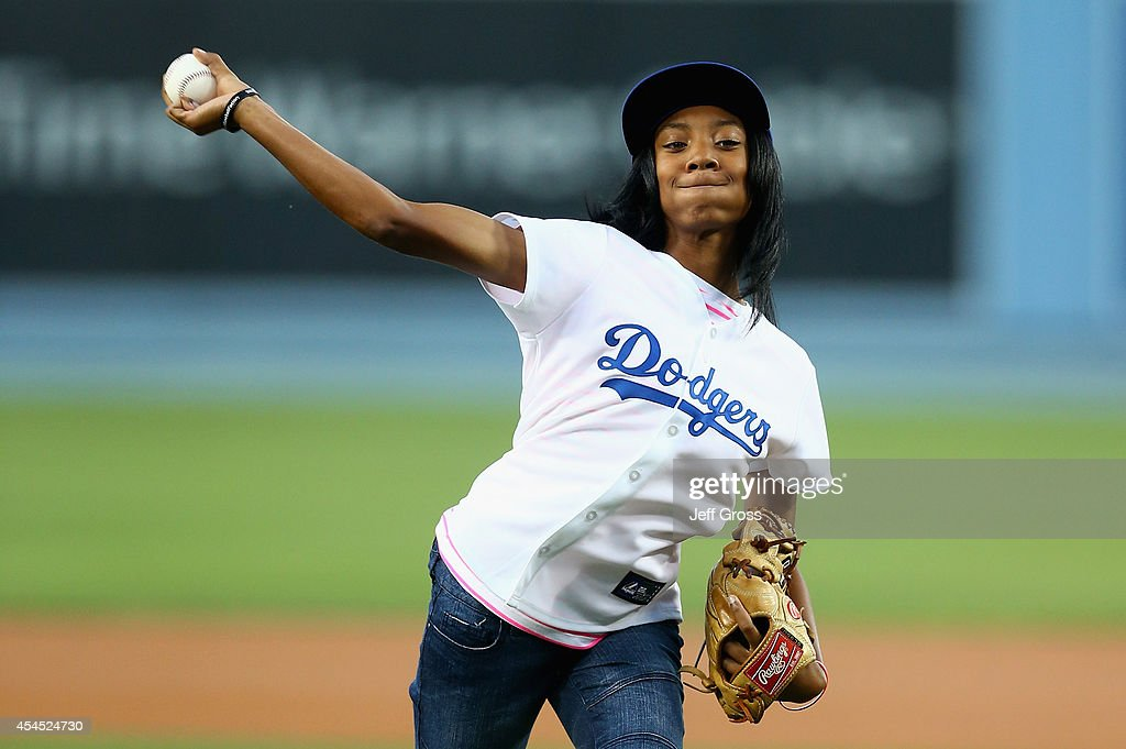 Little League Baseball pitcher <a gi-track='captionPersonalityLinkClicked' href=/galleries/search?phrase=Mo%27ne+Davis&family=editorial&specificpeople=13503588 ng-click='$event.stopPropagation()'>Mo'ne Davis</a> throws out the ceremonial first pitch prior to the start of the game between the Los Angeles Dodgers and the Washington Nationals at Dodger Stadium on September 2, 2014 in Los Angeles, California.
