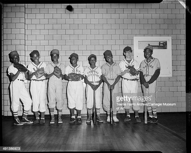 Little League baseball players from Pittsburgh Lions B M Restaurant Elks Fireman's and Satans teams posed in gym Pittsburgh Pennsylvania May 1955...