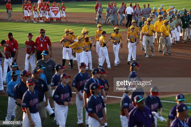 Little League baseball players look on before the Pittsburgh Pirates play the St Louis Cardinals in the inaugural MLB Little League Classic at BBT...